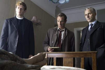 TV STILL -- DO NOT PURGE --  Grantchester Sundays, January 18 - February 22, 2015  10pm ET on MASTERPIECE on PBS  Episode Three  Sunday, February 1, 2015 at 10 - 11pm ET  An old woman tells Sidney that someone wants her dead. Then she dies. Coincidence? The new curate delivers a  surprising sermon.  Shown from left to right: James Norton as Sidney Chambers, Robson Green as Inspector Keating, and Mark Bonnar as Dr. Robinson (C) Des Willie/Lovely Day Productions & ITV for MASTERPIECEÜ This image may be used only in the direct promotion of MASTERPIECE. No other rights are granted. All rights are reserved. Editorial use only.